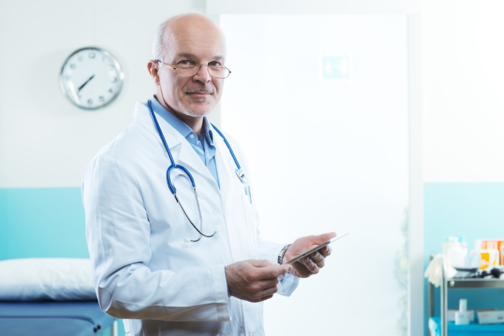 a doctor holding a smart tablet with all patient data