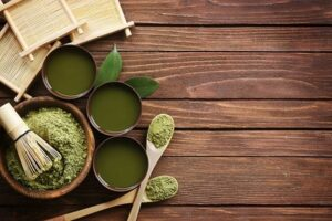 Bamboo whisks and bowls of matcha