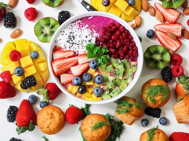 A smoothie bowl surrounded by fruit