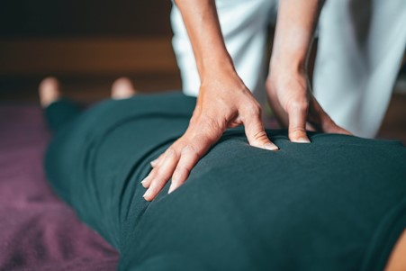 a therapist applying deep pressure during a massage