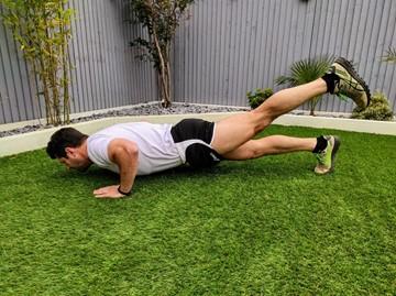 a man exercising outdoors