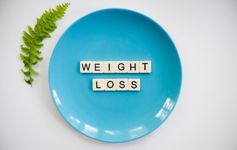 A sign that says weight loss
