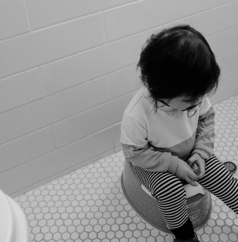 A child sitting on the potty