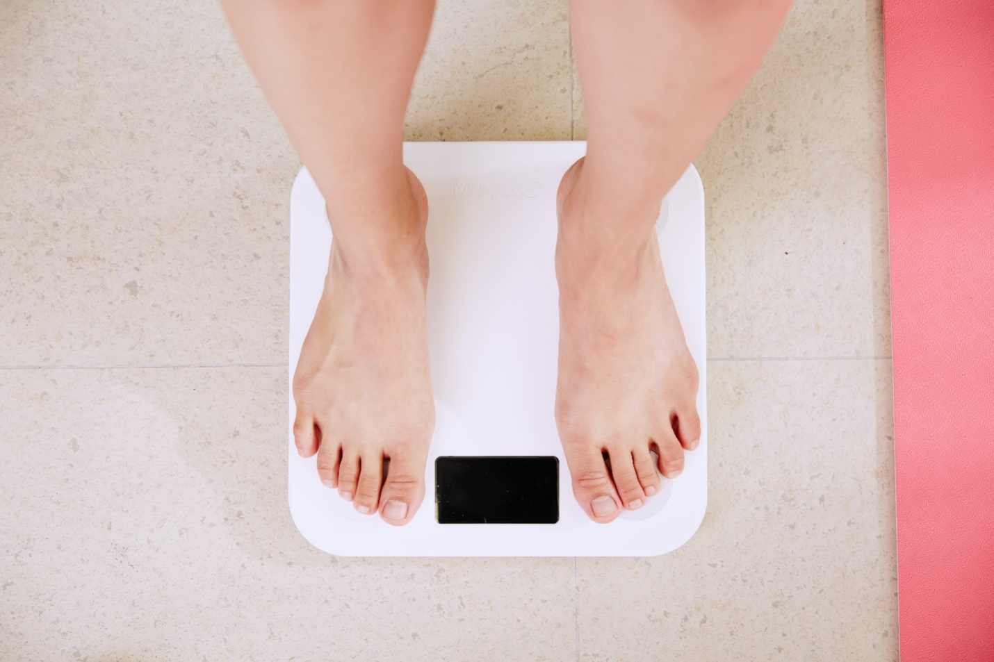 A person standing on the bathroom scale