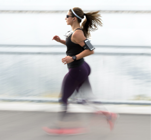 A person jogging wearing a fitness tracker