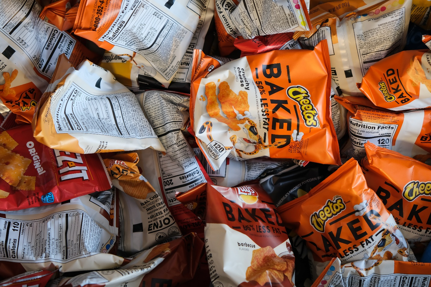A lot of baked Cheetos packs